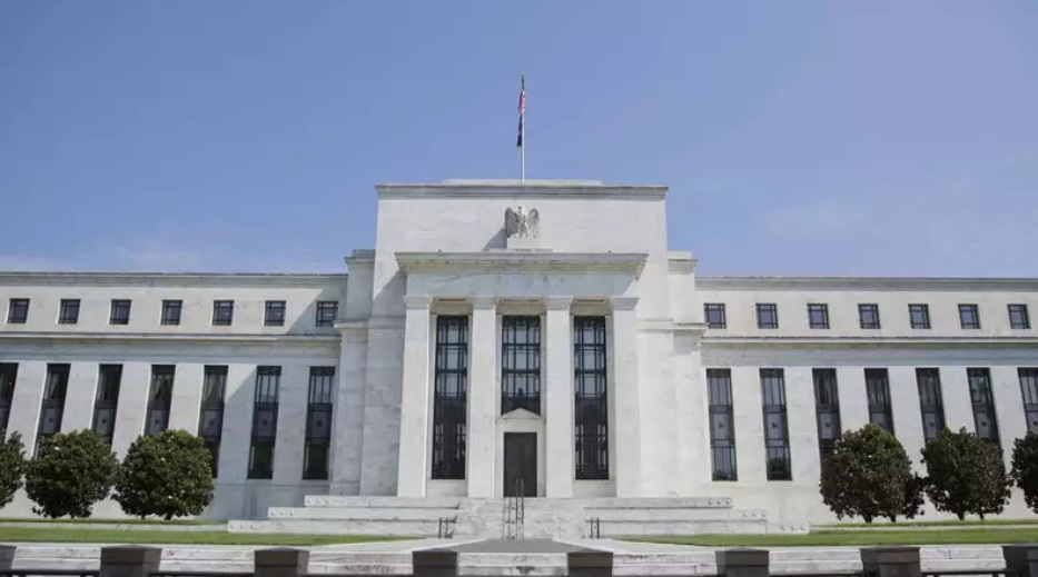 Two Fed officials disagree with decision to cut interest rates