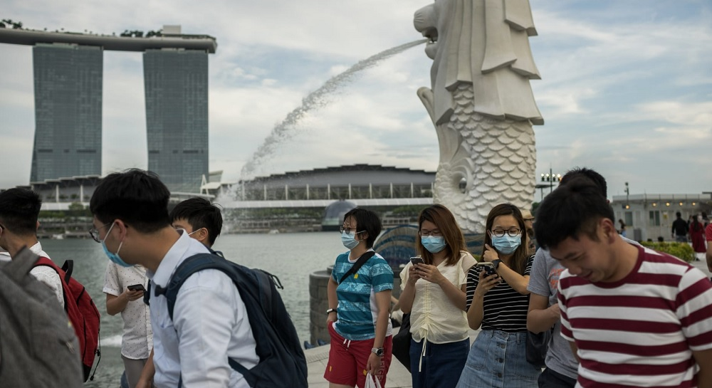 Singapore must prepare for a continued rise in coronavirus cases, minister says