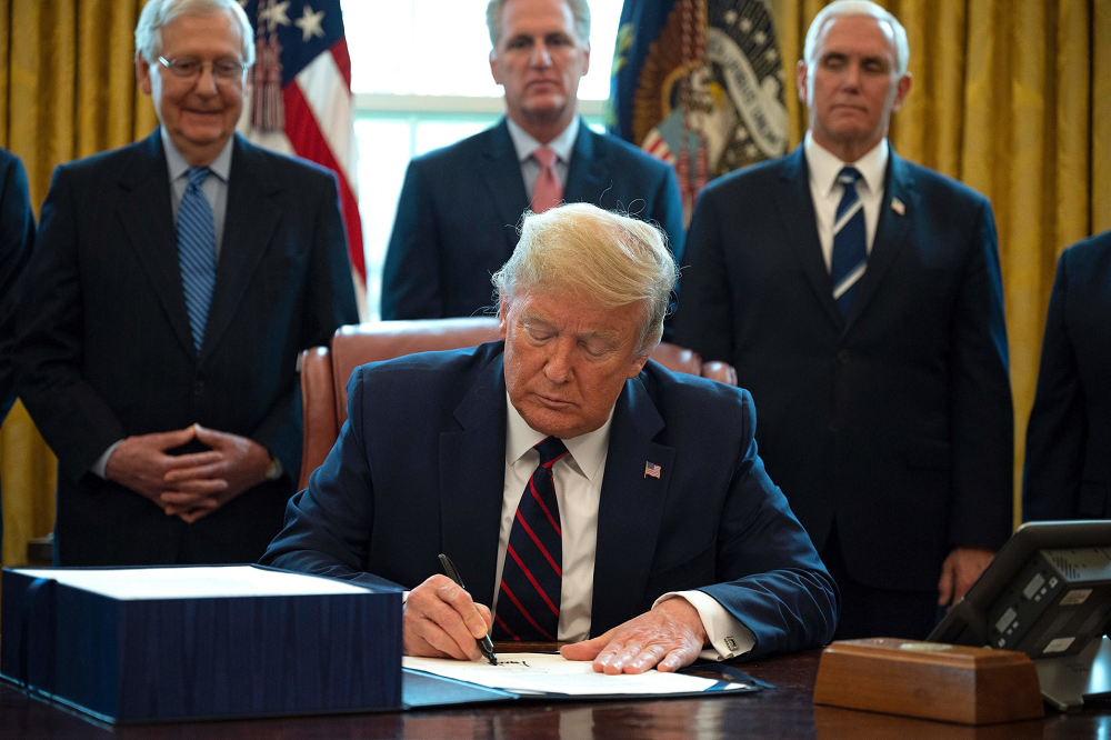 Trump signs $2 trillion coronavirus relief bill as the US tries to prevent economic devastation