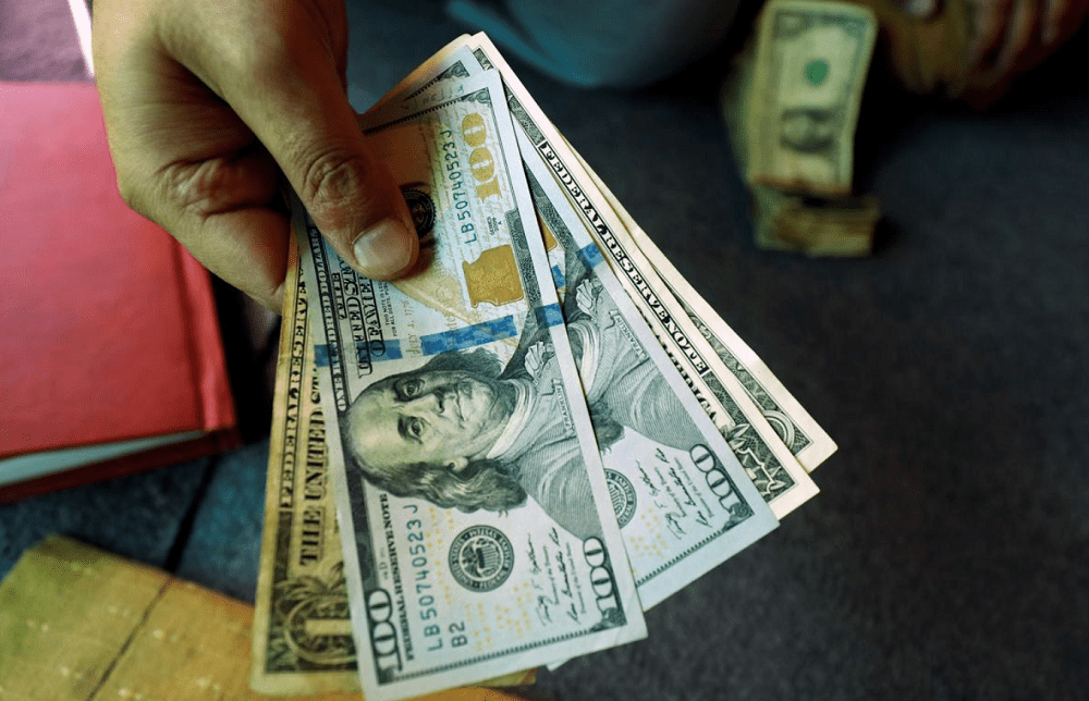 Dollar grinds higher as U.S.-China tensions and virus unnerve investors